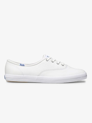 Model in white leather Keds Champion Original Leather Sneaker