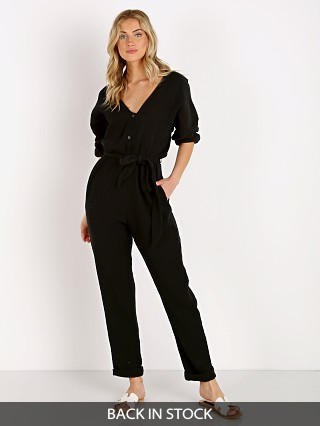 Model in black Stillwater Cote D'Azure Jumpsuit