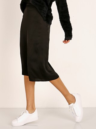 Model in black Stillwater The Silky Midi Skirt