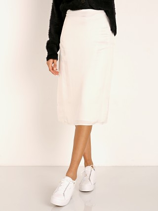 Model in white Stillwater The Silky Midi Skirt