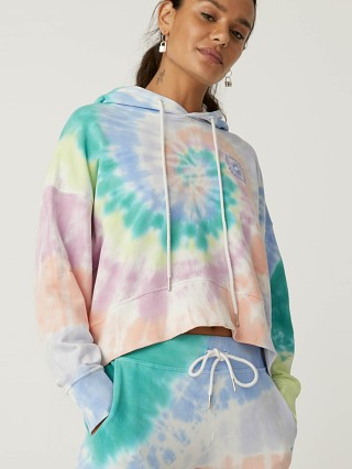 Model in prismatic tie dye Daydreamer La Eye Shrunken Hoodie