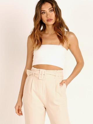 Model in white Stillwater Flirt Rib Crop Tank