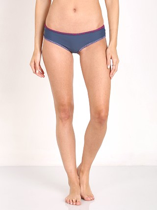 Model in blue House of Au+Ora Easy Rider Bikini Bottom
