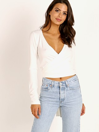 Model in white Stillwater Tiny Dancer Wrap Top