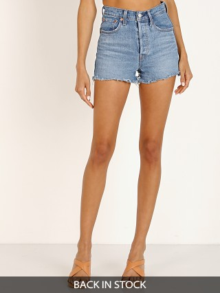 Model in urban oasis Levi's Ribcage High Waisted Short