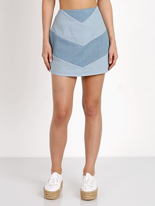 Model in blue Wyldr Low Rider Denim Skirt