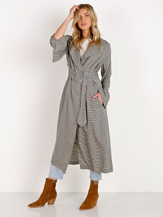 Model in baby gingham Capulet Danna Trench Coat
