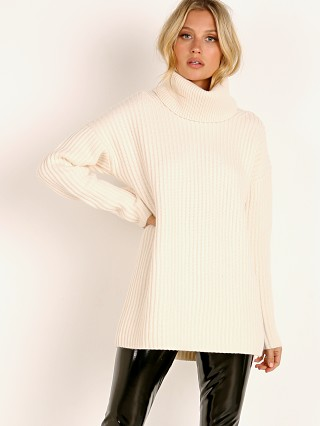 You may also like: NAADAM Cashmere Cut Out Turtleneck Pullover White