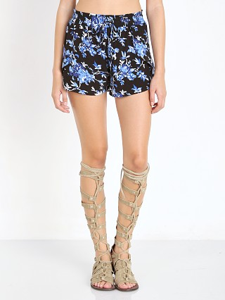 Model in dark flower Flynn Skye Get Waisted Shorts