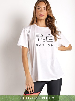 Model in white PE NATION Heads Up Tee