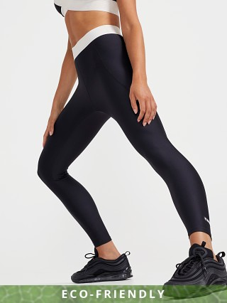 Model in black PE NATION Front Runner Legging