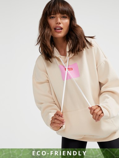 Model in pearled ivory PE NATION In Swing Hoodie