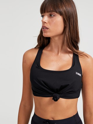 Model in black PE NATION Alliance Sports Bra