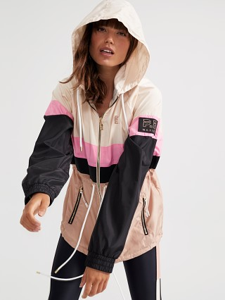 Model in coral pink PE NATION Speed Cut Jacket