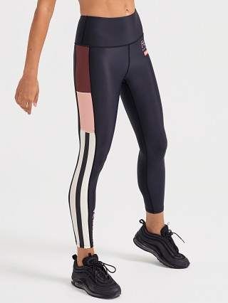 Model in black PE NATION Bardown Leggings