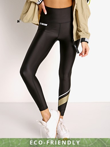 Model in black PE NATION Fortify Legging