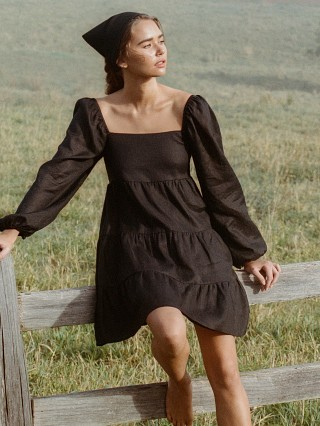 Model in black Faithfull the Brand Morissa Mini Dress  Linen