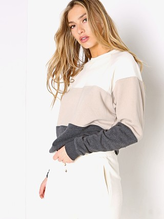 Model in creme/stone/charcoal DONNI. Vintage Fleece Tri-Crew Sweatshirt