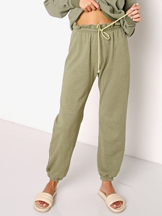 Model in basil DONNI. Vintage Fleece Gem Sweatpant
