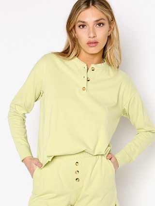Model in lime DONNI. Henley Long Sleeve