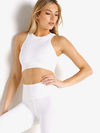 Model in white NUX One By One Crop Top