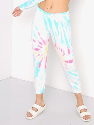 Model in sunburst tie dye Spiritual Gangster Perfect Terry Sweatpant