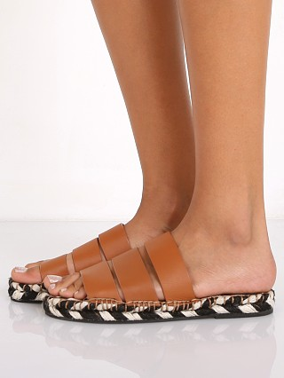 Model in tan SOL SANA Lawrence Sandal Brunt
