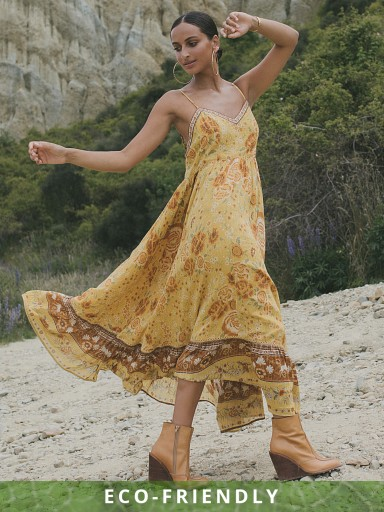 Model in sunflower Spell Mystic Strappy Maxi Dress