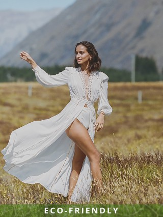 Model in off white Spell & The Gypsy Le Gauze Lace Duster