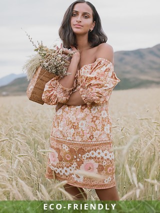 Model in peach Spell & The Gypsy Anne Tunic Dress