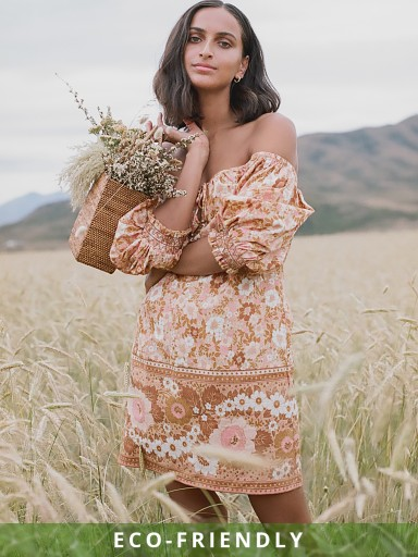 Model in peach Spell Anne Tunic Dress
