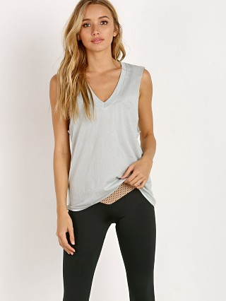 Model in sky Olympia Activewear Viv Tank