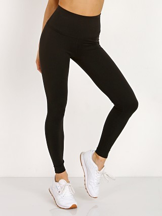 Model in jet black Beyond Yoga High Waisted Midi Legging
