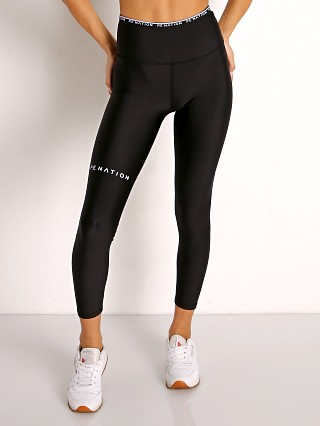 Model in black PE NATION Power Play Legging