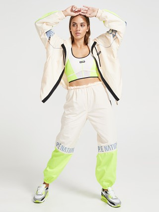 Model in pearled ivory grey PE NATION First Position Trackpant