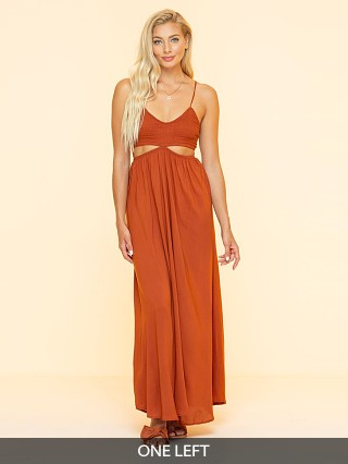 Model in copper Indah Innocence Cutaway Maxi Dress