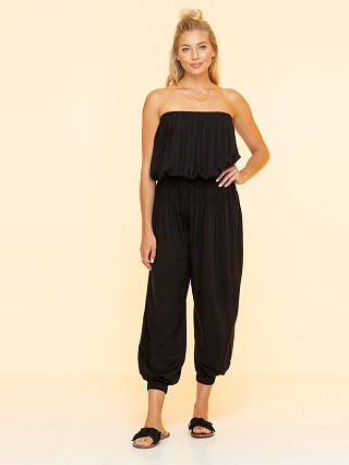Model in black Indah Seychelles Strapless Jumper