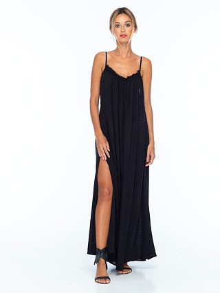 Model in black Indah Yasmine Solid Maxi Dress