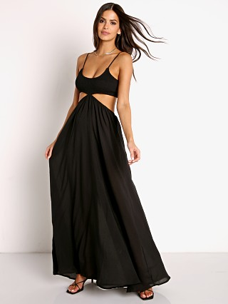 Model in black Indah Innocence Cutaway Maxi Dress